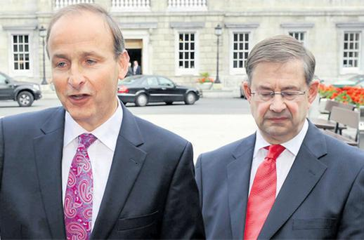Fianna Fail leader Micheal Martin has faced down a mini-rebellion and sacked his deputy leader Eamon O Cuiv, grandson of Eamon de Valera, ahead of the party's 73rd Ard Fheis this weekend