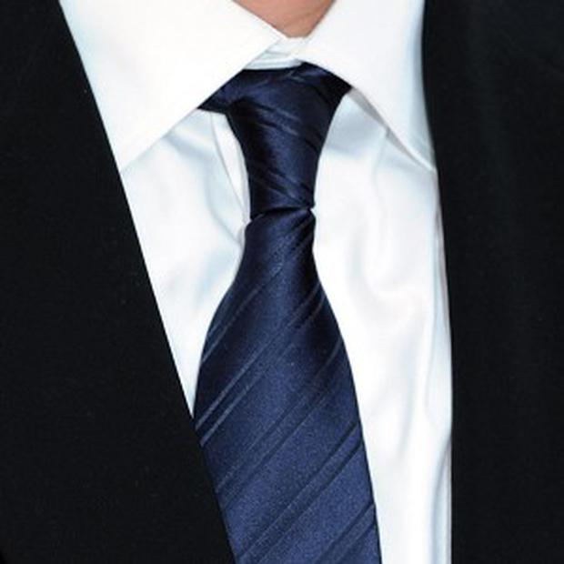 Office workers could soon wave goodbye to the necktie. according to a poll
