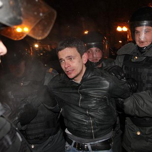 Russian police officers detain opposition leader Ilya Yashin after an unsanctioned protest in Moscow (AP)