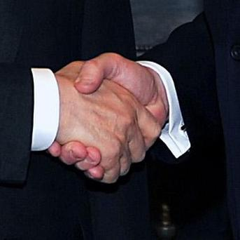 Shaking hands might be off-limits for athletes at the London Olympics, a medical expert has warned