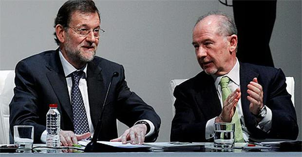Mariano Rajoy (left) and Rodrigo Rato (right) at a conference in Madrid