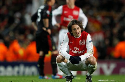 So close: Arsenal's Tomas Rosicky after being defeated by AC Milan in the Champions League last 16. Photo: Reuters