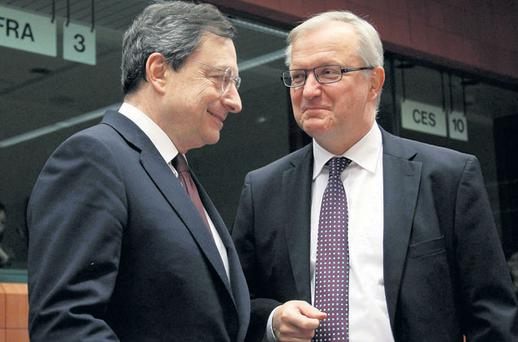 PART OF THE TROIKA: European Central Bank president Mario Draghi, left, talks with EU Monetary Affairs Commissioner Olli Rehn at a European Union finance ministers meeting