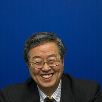 China's Central Bank Governor Zhou Xiaochuan at a press conference in Beijing (AP/Alexander F Yuan)