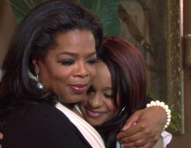 Oprah Winfrey gives a hug to Bobbi Kristina Brown, daughter of the late singer Whitney Houston REUTERS/Copyright 2012 Harpo, Inc./Handout
