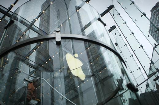 Apple shares, up 2.5pc at $582.52, posted a sixth straight day of gains and helped to limit the broader market's losses. Photo: Getty Images