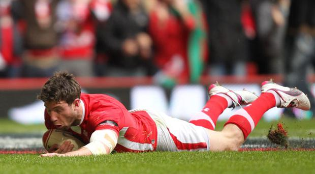 Wales' Alex Cuthbert scores the opening try