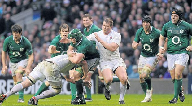Ireland's Sean O'Brien is tackled by Ben Morgan (l) and Dylan Hartley during England's emphatic 30-9 victory in the Six Nations at Twickenham yesterday