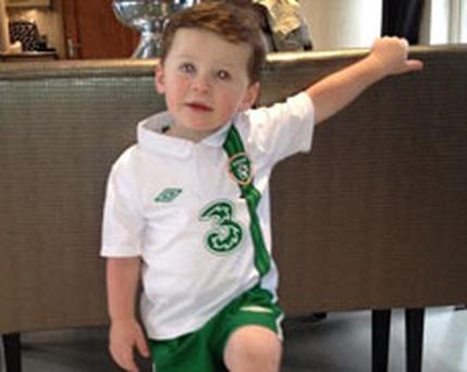 Wayne Rooney's son Kai proudly wears the kit of the Boys in Green