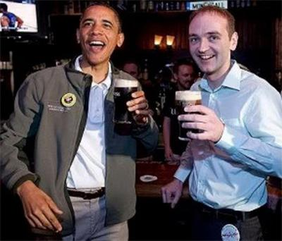 US President Barack Obama celebrates St. Patrick's Day with his ancestral cousin Henry Healy during a stop at the Dubliner pub in Washington