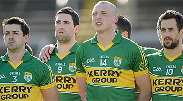 Kerry players stand for a minute's silence in respect of Kieran Donaghy's father