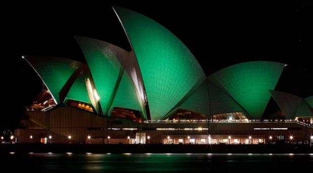 SYDNEY, AUSTRALIA - MARCH 17: The Sydney Opera House is illuminated green on March 17, 2012 in Sydney, Australia. The Sydney Opera House joins Sky Tower in Auckland, and Table Mountain in South Africa in going green to celebrate St. Patrick's Day. (Photo by Brendon Thorne/Getty Images) ***BESTPIX***