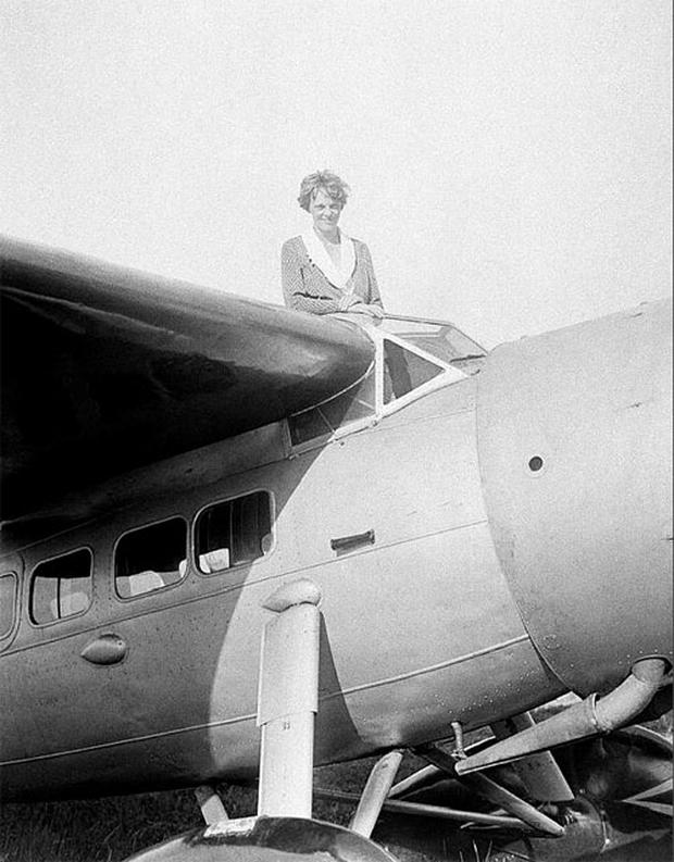 In this undated photo, Amelia Earhart, the first woman to cross the Atlantic Ocean by plane sits on top of a plane. Photo: AP