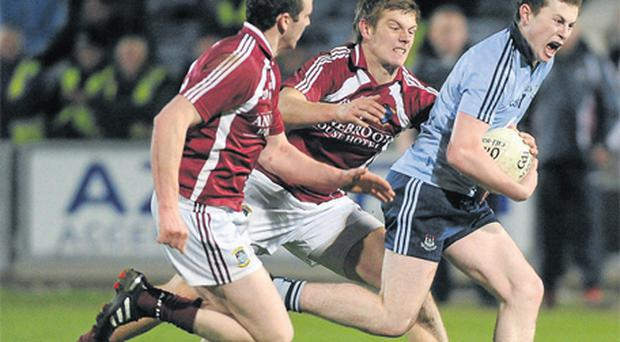 Jack McCaffrey bursts past Westmeath's John Heslin and Alan Stone