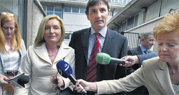 Celia Larkin accompanied by her solicitor, Hugh Millar, leaving the Mahon Tribunal at Dublin Castle