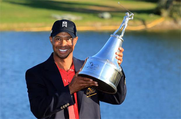 Tiger Woods of the USA proudly holds the trophy during the final round of the 2012