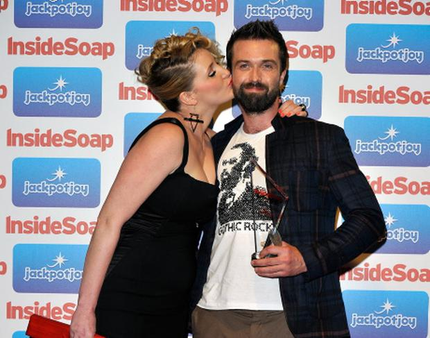 Inside Soap Awards 2011...LONDON, ENGLAND - SEPTEMBER 26: (L-R) Bronagh Waugh and actor Emmett J Scanlan from Hollyoaks with his Best Newcomer Award during the Inside Soap Awards 2011 at Gilgamesh on September 26, 2011 in London, England. (Photo by Gareth Cattermole/Getty Images)...E