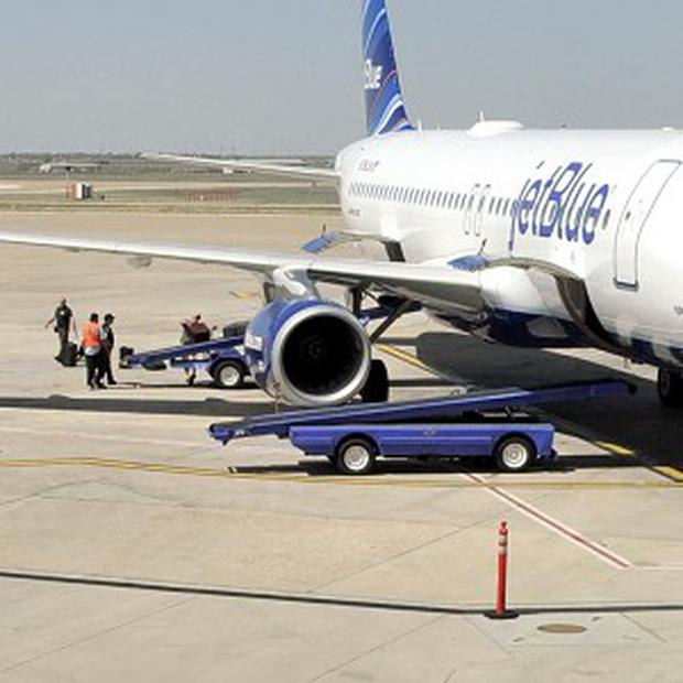 Officials search for explosives on JetBlue flight 191 at Amarillo Airport in Texas (The Amarillo Globe News)