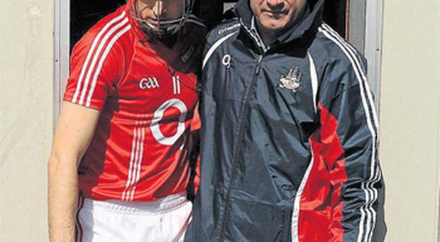 Cork's Pa Cronin follows Jimmy Barry Murphy out of their temporary dressing rooms at Pairc Ui Rinn