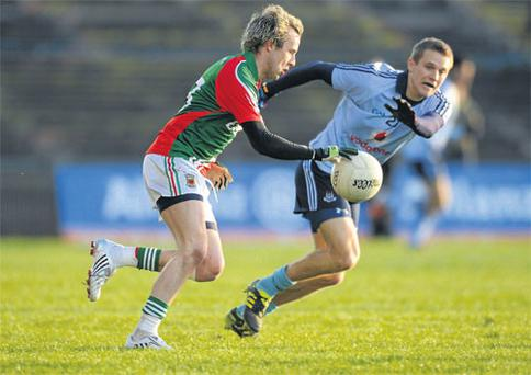 Conor Mortimer tries to get past Thomas Quinn.