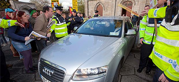 Tensions rise: protesters surround Phil Hogan's car in Carlow yesterday