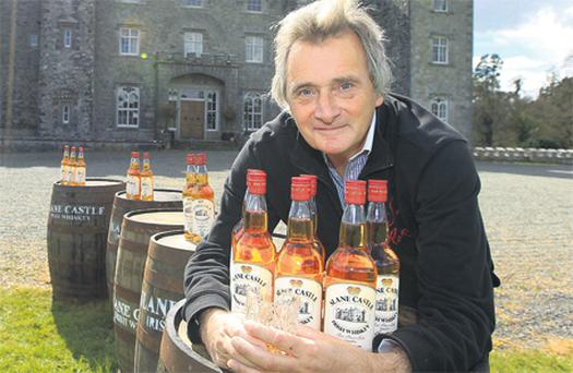 Lord Henry Mountcharles with his own brand 'Slane Castle' whiskey