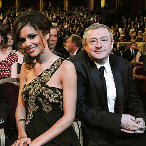 Cheryl Cole and Louis Walsh have ended their feud