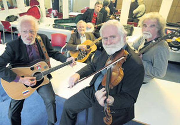 The new Dubliners – Eamonn Campbell, Sean Cannon, Gerry O'Connor, John Sheahan and Patsy Watchorn – in their dressing room at the National Concert Hall