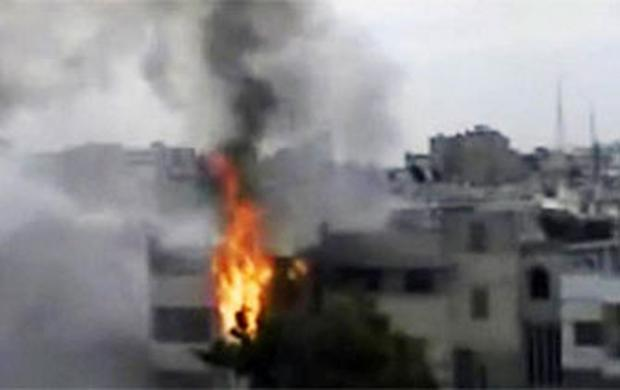 A building is on fire following purported shelling in Homs, Syria. Syrian troops are reported to have shelled residential neighborhoods dominated by rebels in the central city of Homs Sunday.