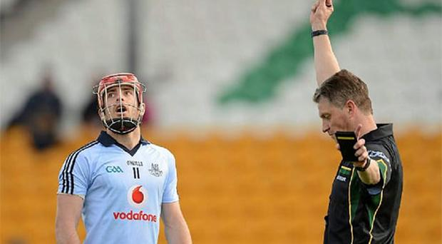 Ryan O'Dwyer, Dublin, is shown a red card and sent off by referee Barry Kelly.