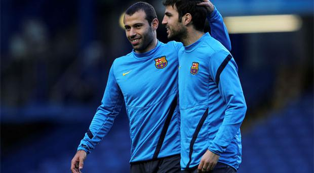 Barcelona's Javier Mascherano and Cesc Fabregas smile during a team training session at Stamford Bridge prior to their Champions League semi-final first leg match against Chelsea. Photo: Reuters