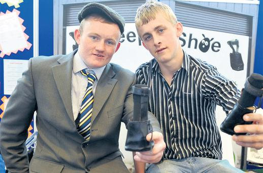 Conor McGrath, left and Shaun McGloin, from Marist College, Athlone, with their 'Sheep Shoe' entry for the Student Enterprise Awards at Croke Park yesterday
