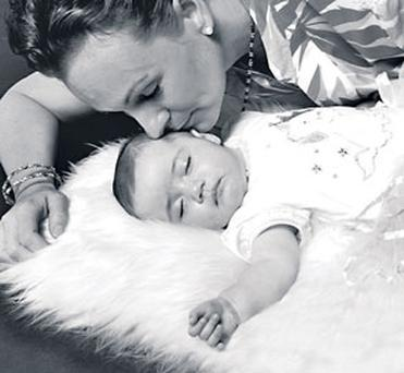 My beautiful baby: Caroline O'Flaherty with little Ava