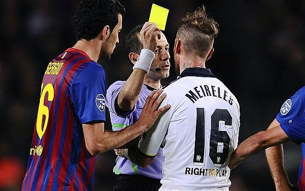 Heartbreak: Raul Meireles pleads with the referee not to book him. Photo: Getty Images