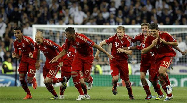 Bayern Munich players celebrate after winning a semi final second leg Champions League soccer match against Real Madrid at the Santiago Bernabeu stadium, in Madrid. Photo in 2012