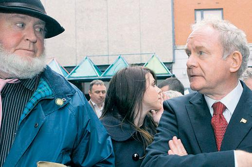 Martin McGuinness with tour guide Proinsias O'Rathaille on a guided walk of Moore Street. Photo: SAM BOAL/PHOTOCALL IRELAND