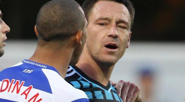 File photo dated 23/10/11 of Chelsea captain John Terry (right) speaking with QPR's Anton Ferdinand during the Barclays Premier League match at Loftus Road. PRESS ASSOCIATION Photo. Issue date: Thursday April 26, 2012. The Premier League have announced there will be no pre-match handshake at Sunday's game between Chelsea and QPR due to the legal situation involving John Terry and Anton Ferdinand. See PA story SOCCER Ferdinand. Photo credit should read: Nick Potts/PA Wire