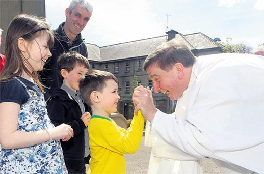 Fr Brian D'Arcy sharing a laugh with his parishioners after he celebrated Mass in the chapel of the Passionist Monastery in Enniskillen, Co Fermanagh, yesterday, where he received a standing ovation