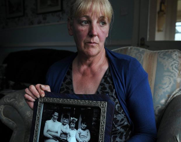 Helen McKendry, daughter of Jean McConville, with the only photograph the family have of their mother