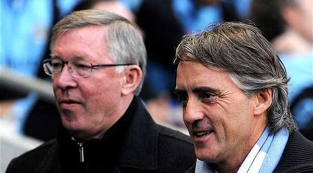 Going our separate ways: Roberto Mancini (right) and his United counterpart had different ideas Photo: Reuters