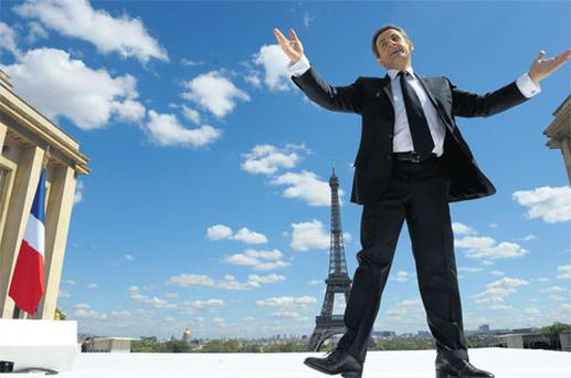 French president Nicolas Sarkozy greets supporters as he arrives at a mass rally in Paris yesterday.