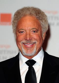 File photo dated 12/02/2012 of Sir Tom Jones, who has admitted that he regrets spending so many years covering up his grey hair. PRESS ASSOCIATION Photo. Issue date: Tuesday April 24, 2012. The Voice star, 71, surprised fans three years ago when he finally stopped colouring his trademark thick, curly locks. See PA story SHOWBIZ Jones. Photo credit should read: Ian West/PA Wire