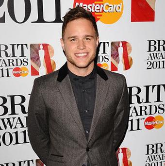 Olly Murs said he's pleased that One Direction have cracked the US