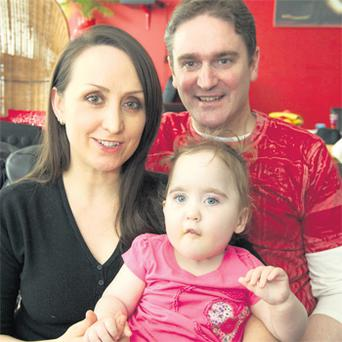 Parents Eddie and Esti Madden with daughter Elie at home in Dublin yesterday