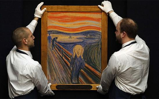 Sotheby's employees posing for a photograph with Edvard Munch's picture