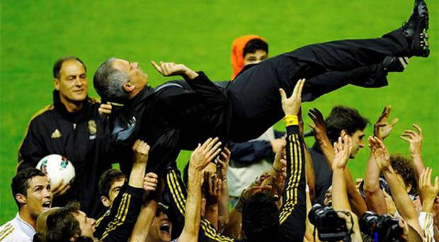 Real Madrid's coach Jose Mourinho is thrown into the air by his players after their win over Athletic Bilbao. Photo: Reuters