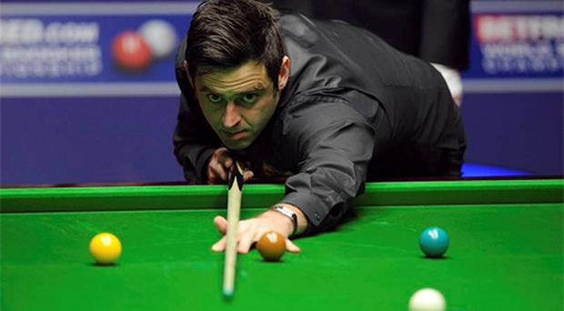 Ronnie O'Sullivan in action during his quarter final match against Australia's Neil Robertson. Photo: PA
