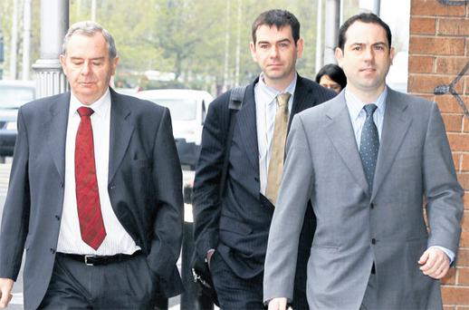 Former billionaire Sean Quinn arriving at the Four Courts yesterday for the High Court contempt action brought by IBRC, formerly Anglo Irish Bank, with his son, Sean Quinn junior (centre), and son-in-law, Niall McPartland (right). Photo: Collins