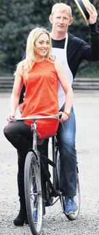 RTE presenter Kathryn Thomas and Leinster captain Leo Cullen launch the Bloomsday bike rally in Dublin's Iveagh Gardens yesterday