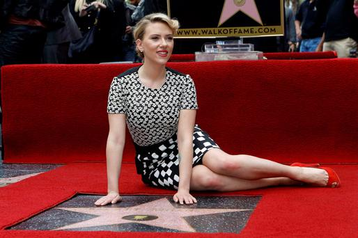 Actress Scarlett Johansson poses by her star after it was unveiled on the Walk of Fame in Hollywood, California May 2, 2012. REUTERS/Mario Anzuoni (UNITED STATES - Tags: ENTERTAINMENT)